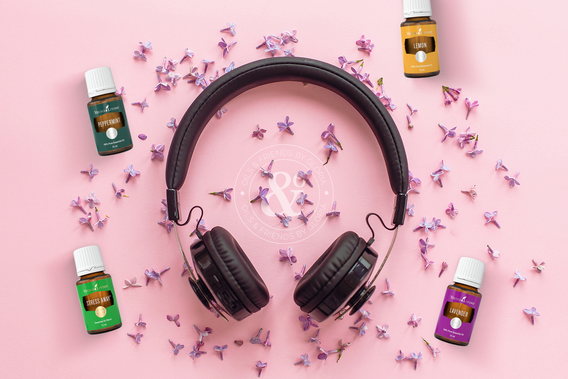 stylish black headphones on pink background with lilac flowers.